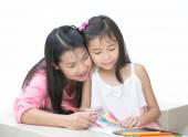Mon and girl drawing a home work — Stock Photo