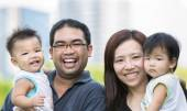 Happy asian mother, father and twins child — Stock Photo