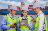 The engineer working with container Cargo freight ship — Stock Photo