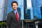 Handsome businessman in city — Stock Photo