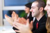 Business people clapping hands — Stock Photo