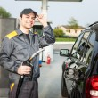 Gas station attendant at work — Stock Photo #54313477