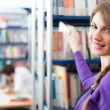 Woman in library — Stock Photo #54315517