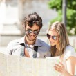 Tourists couple holding map — Stock Photo #54317847