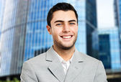 Handsome businessman in city — Stockfoto