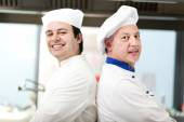 Couple of chefs in kitchen — Stock Photo