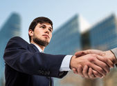 Businessmen shaking their hands — Stock Photo