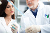Scientists at work in laboratory — Stock Photo