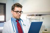 Doctor reading document — Stock Photo