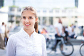 Woman walking in crowded square — Stock Photo