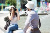 Woman taking picture of boyfriend — Stock Photo