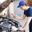 Mechanic using an electronic tester — Stock Photo #54320709