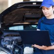 Mechanic using laptop computer — Stock Photo #54320747