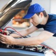 Mechanic using booster cables — Stock Photo #54323783