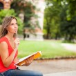 Woman studying outdoors — Stock Photo #54326099