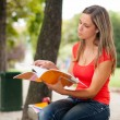Woman studying outdoors — Stock Photo #54326103