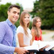 Students studying in park — Stock Photo #54326119