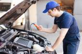 Mechanic using an electronic tester — Stock Photo
