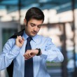 Businessman checking time on watch — Stock Photo #54338901