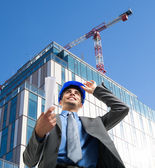 Architect at work in construction site — Foto Stock