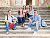 Students sitting on staircase — Stock Photo