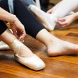 Ballerina putting on pointes — ストック写真 #54347403