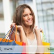 Woman holding shopping bags — Stock Photo #54347521