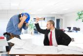 Angry boss attacking worker — Stock Photo