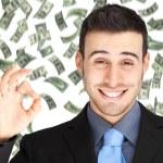 Happy man enjoying rain of money — Stock Photo #54354325