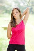 Woman stretching before workout — Stock Photo