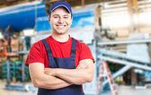 Friendly smiling mechanic — Stock Photo