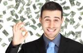 Happy man enjoying rain of money — Foto Stock