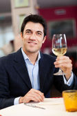 Man holding glass of wine — Stock Photo