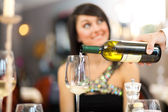 Waiter pouring white wine — Stock Photo