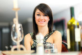 Woman having dinner in restaurant — Foto Stock