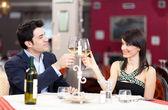 Happy couple toasting glasses — Stock Photo