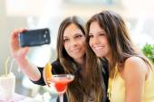 Friends taking self shot with phone — Stock Photo