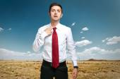 Fired businessman sweating in desert — Stock Photo
