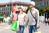 Young tourists shopping in city — Stok fotoğraf