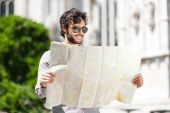 Young tourist with map — Stockfoto