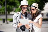 Tourists using tablet — Stok fotoğraf