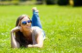 Beautiful woman lying on grass — Stock Photo