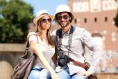 Young couple of tourists in city — Stok fotoğraf