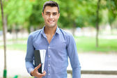 Handsome young student outdoor — Stock Photo