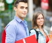 Two students walking outdoor — Stock Photo