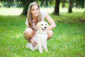 Woman playing with her golden retriever — Stock Photo