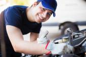 Mechanic servicing car engine — Stock Photo