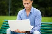 Man using laptop computer outdoors — Stock Photo