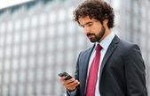Mature businessman using his phone — Stock Photo