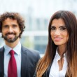 Couple of working business people — Stock Photo #55960435